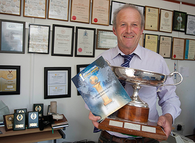 John with Trophy & Awards